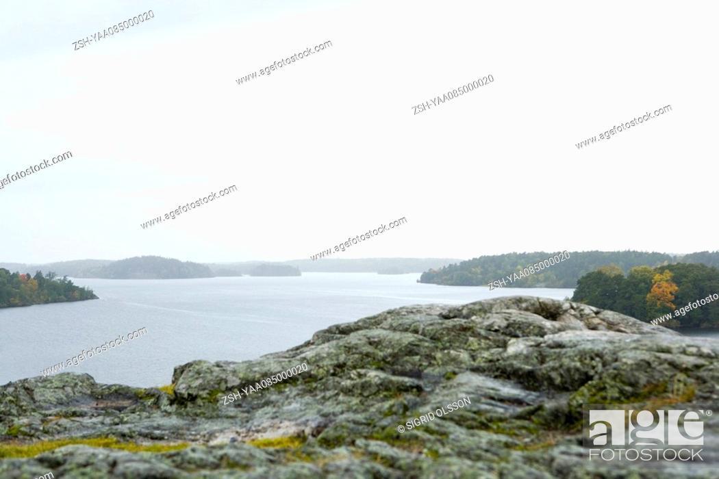 Stock Photo: Lake scene with rocky coast.