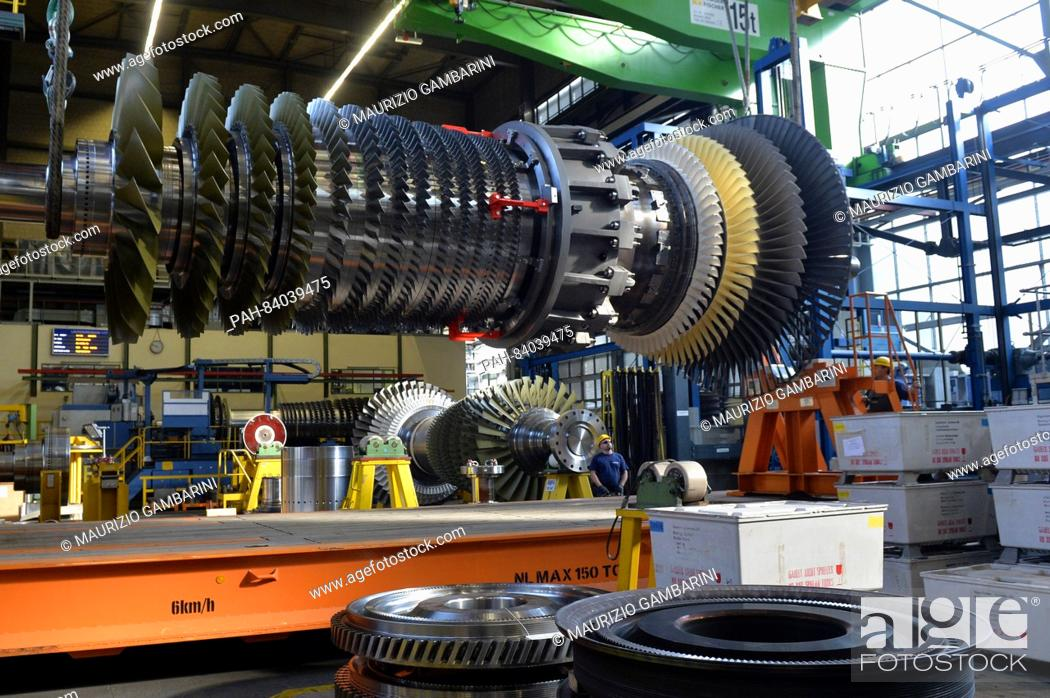 Siemens workers monitor a turbine rotor in a gas turbine in