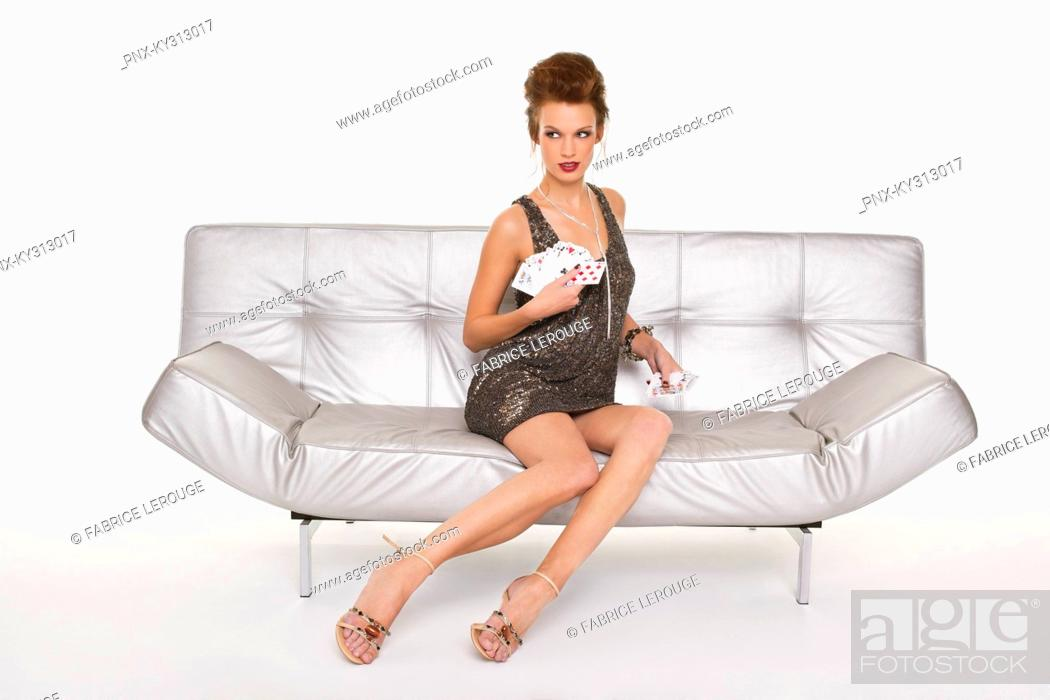 Stock Photo: Young woman in formalwear holding cards.