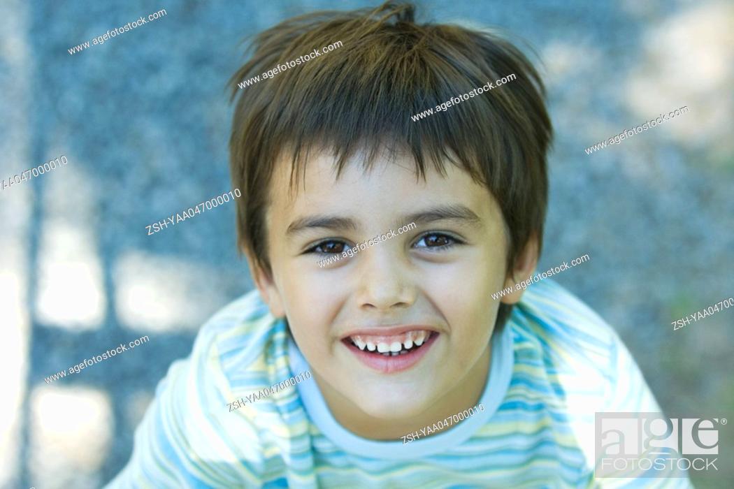 Stock Photo: Boy smiling up at camera.
