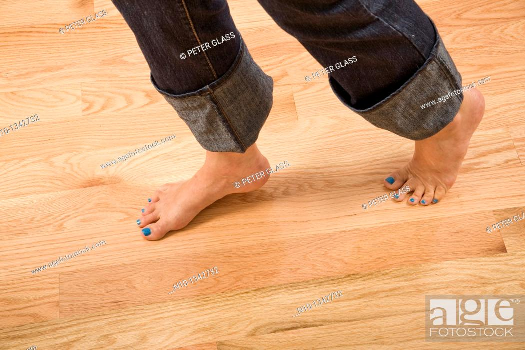 Stock Photo: Middle-age woman's feet.