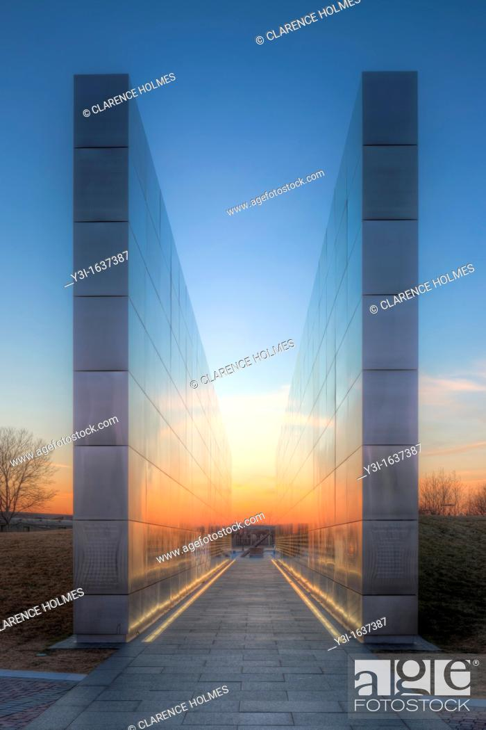 Stock Photo: Twilight colors in the western sky provide a colorful background and reflections on the New Jersey 9/11 Empty Sky Memorial.