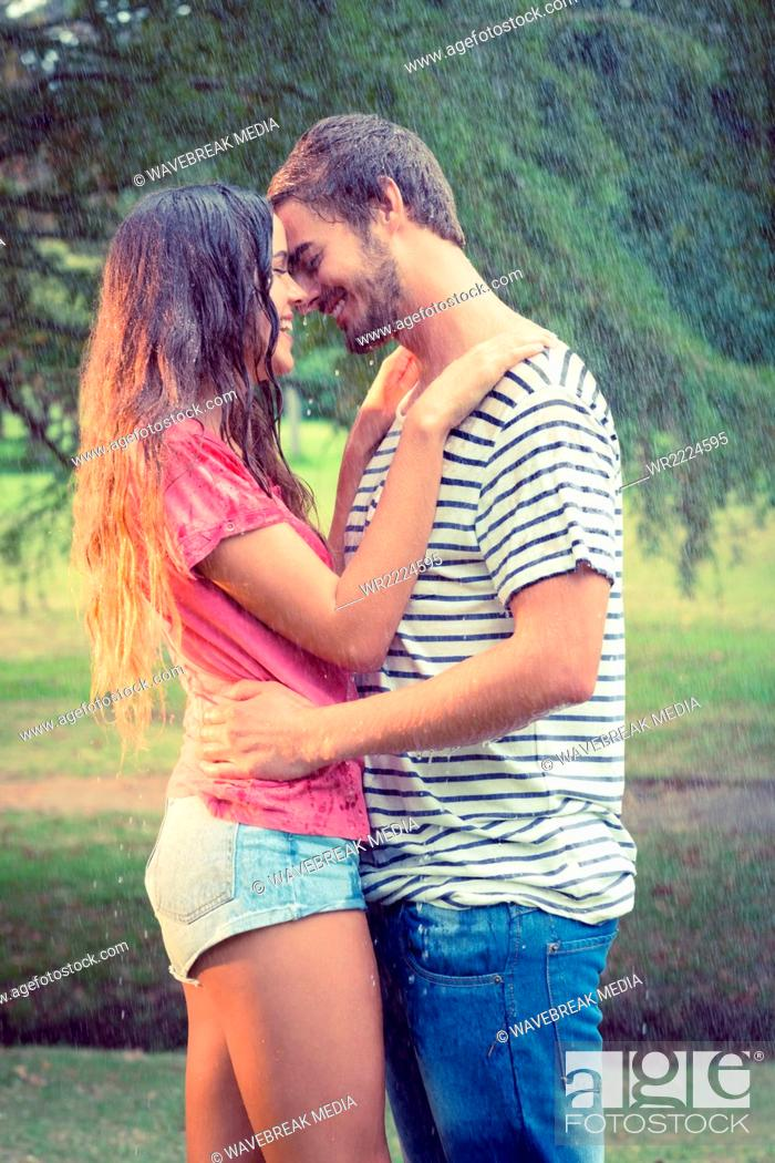 Cute Couple Hugging Under The Rain Stock Photo Picture And Royalty Free Image Pic Wr2224595 Agefotostock