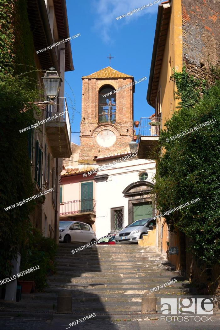 Stock Photo: ancient road and bell tower of the church of the assunta, anguillara sabazia, lazio, italy.