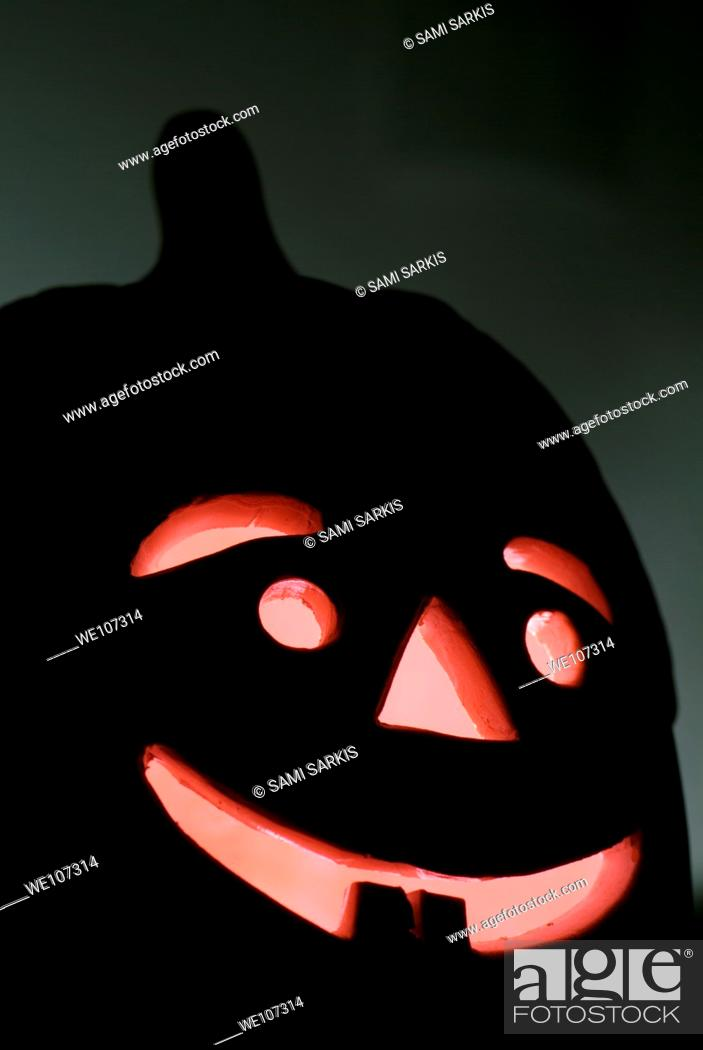 Stock Photo: Halloween Jack o' Lantern glowing at night.