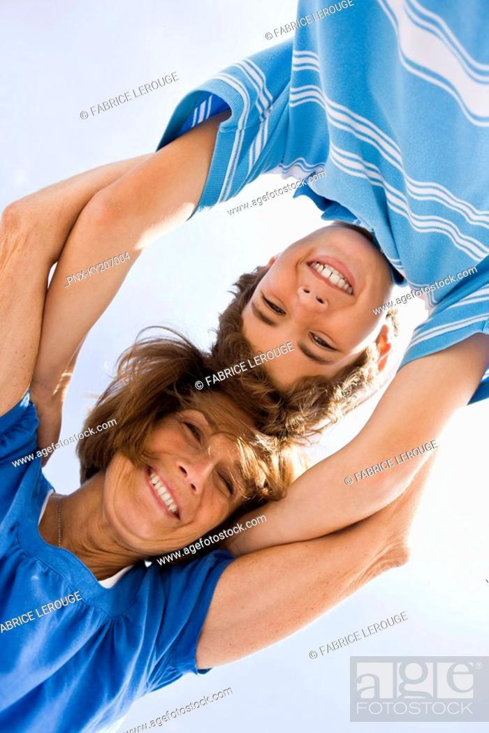 Stock Photo: Woman and her grandson huddle together.
