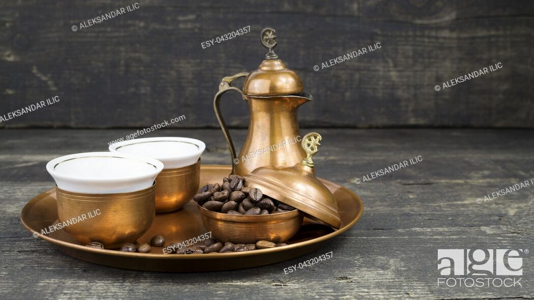 Stock Photo: Turkish coffee with traditional copper serving set and coffee beans.