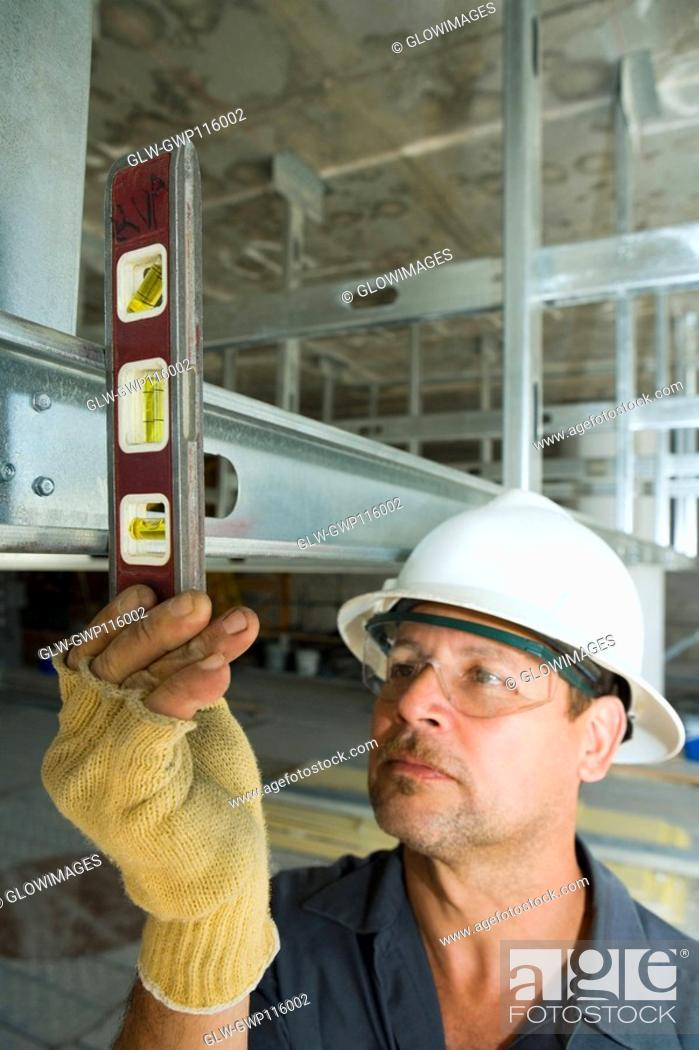 Stock Photo: Close-up of a male construction worker using a spirit level.