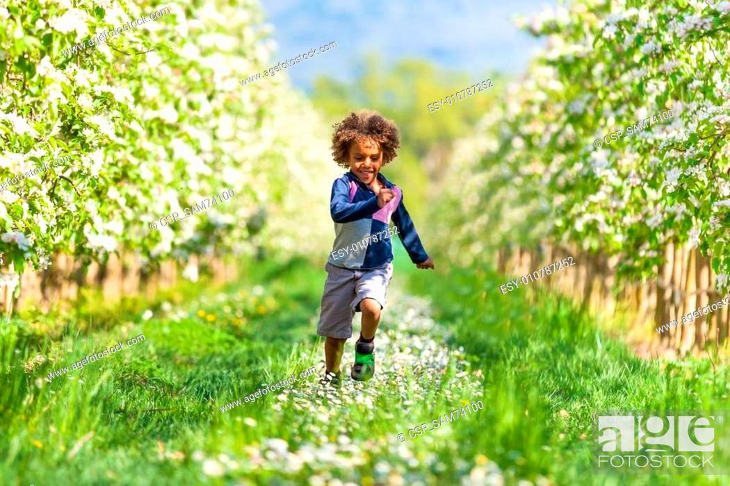 Stock Photo: Cute african american little boy playing outdoor - Black people.