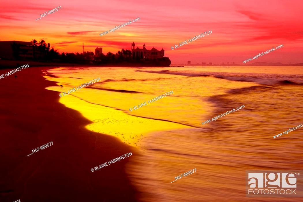 Stock Photo: Beach at the Playa Mazatlan Hotel at sunrise,Valentino's Night Club in background, Mazatlan, Sinaloa, Mexico.