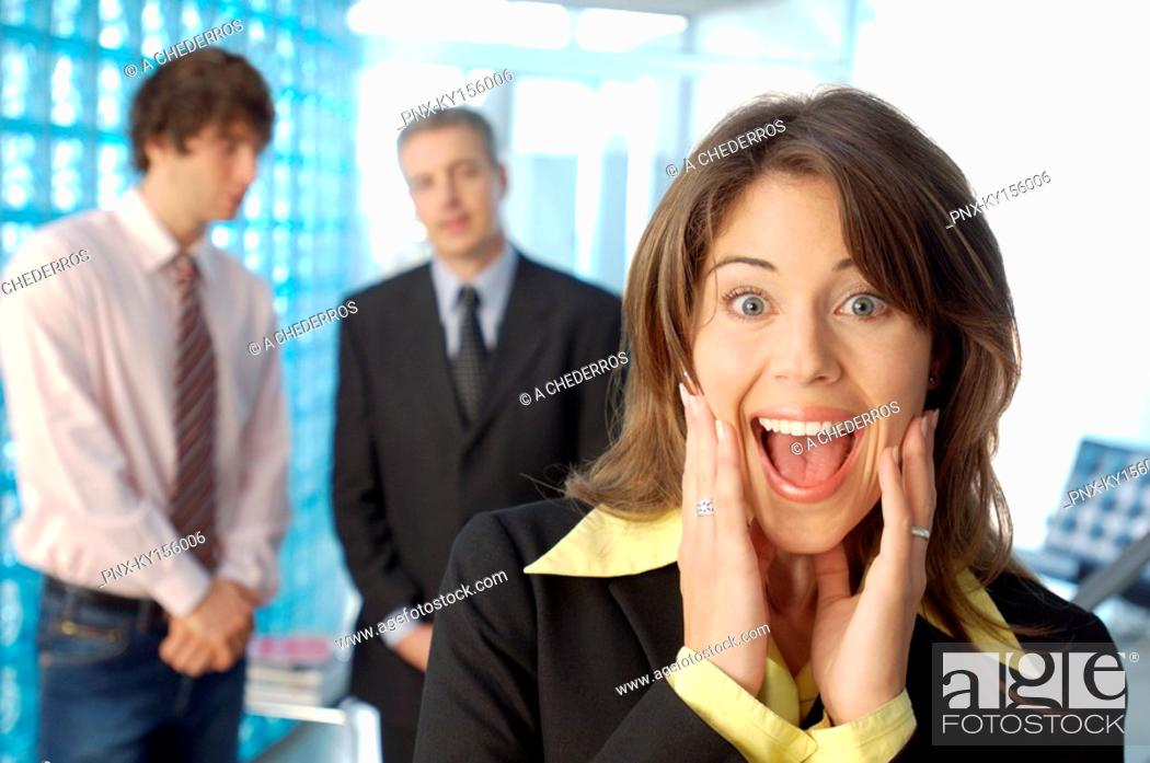 Stock Photo: Businesswoman screaming with colleagues in background.