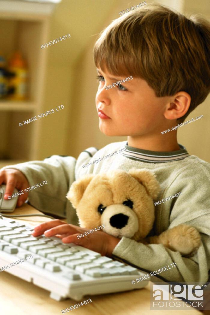 Stock Photo: Boy at computer.