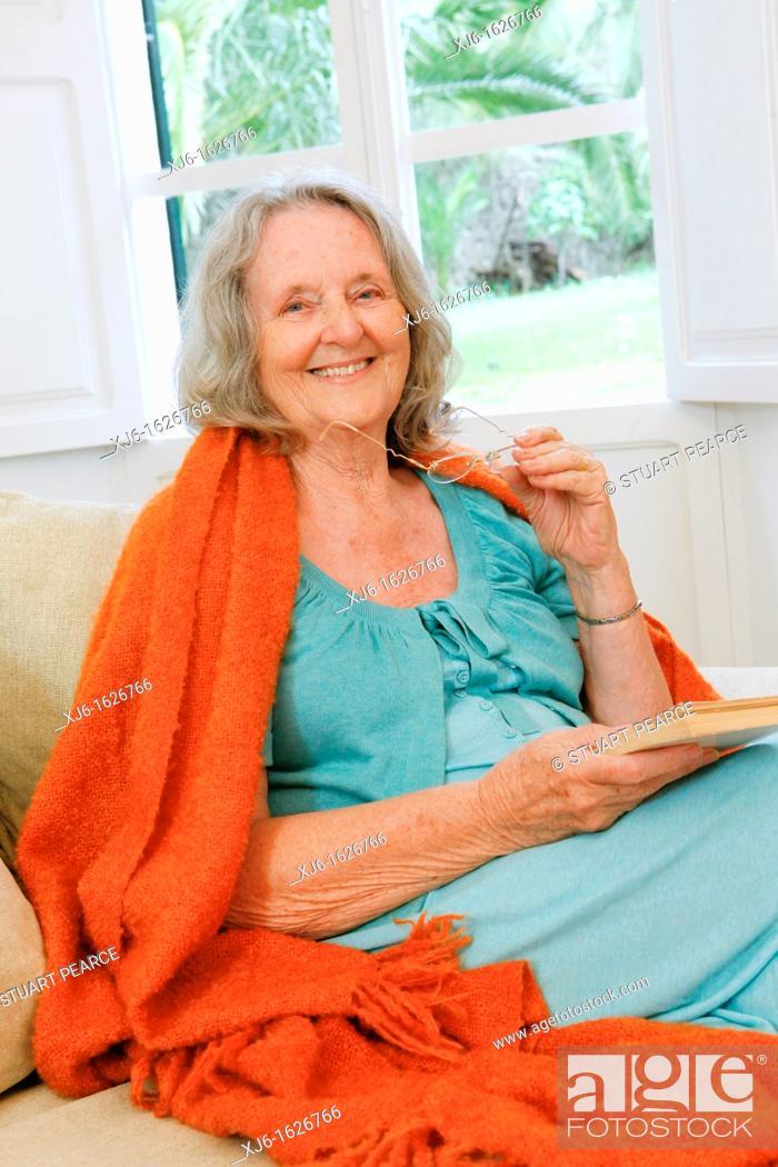 Stock Photo: Senior woman reading a book.