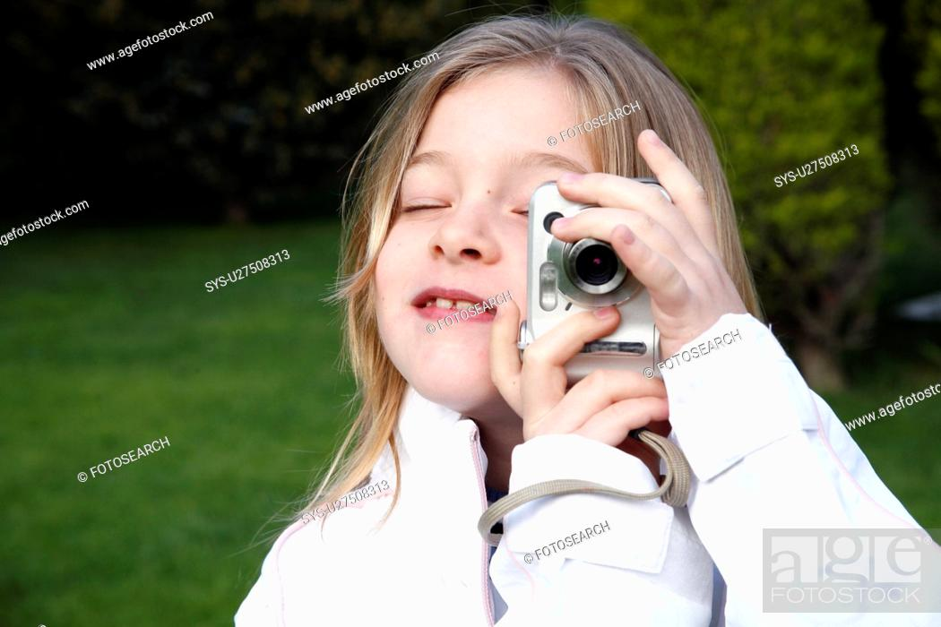 Stock Photo: Little girl holding a camera.