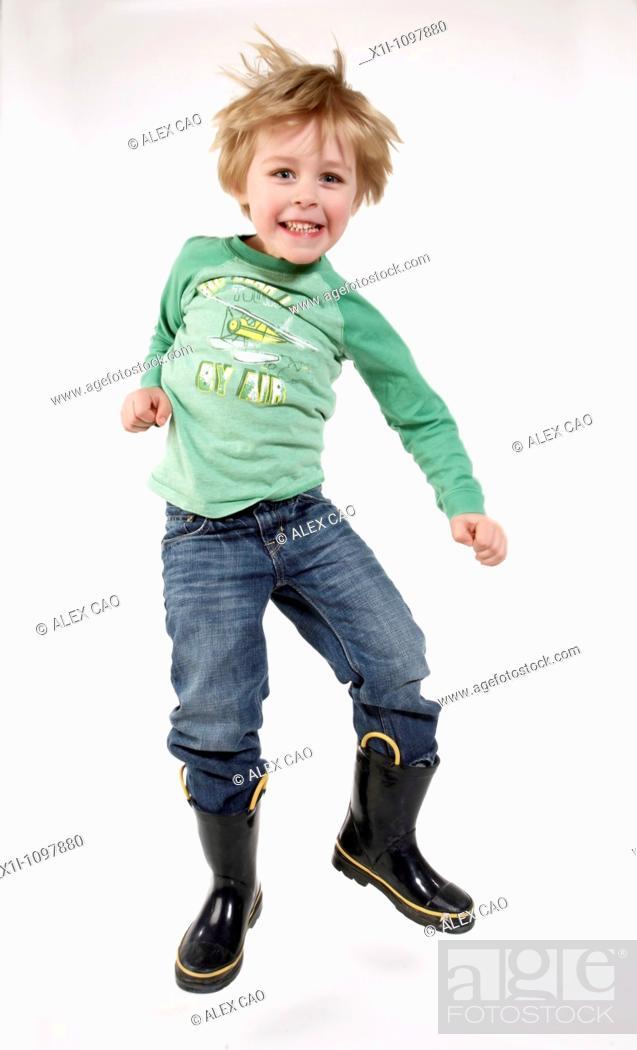 Stock Photo: Boy jumping.