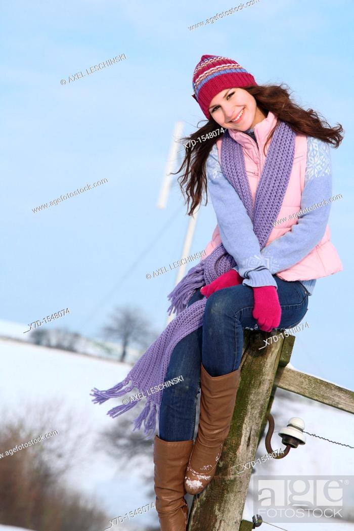 Stock Photo: woman walking in winter landscape.