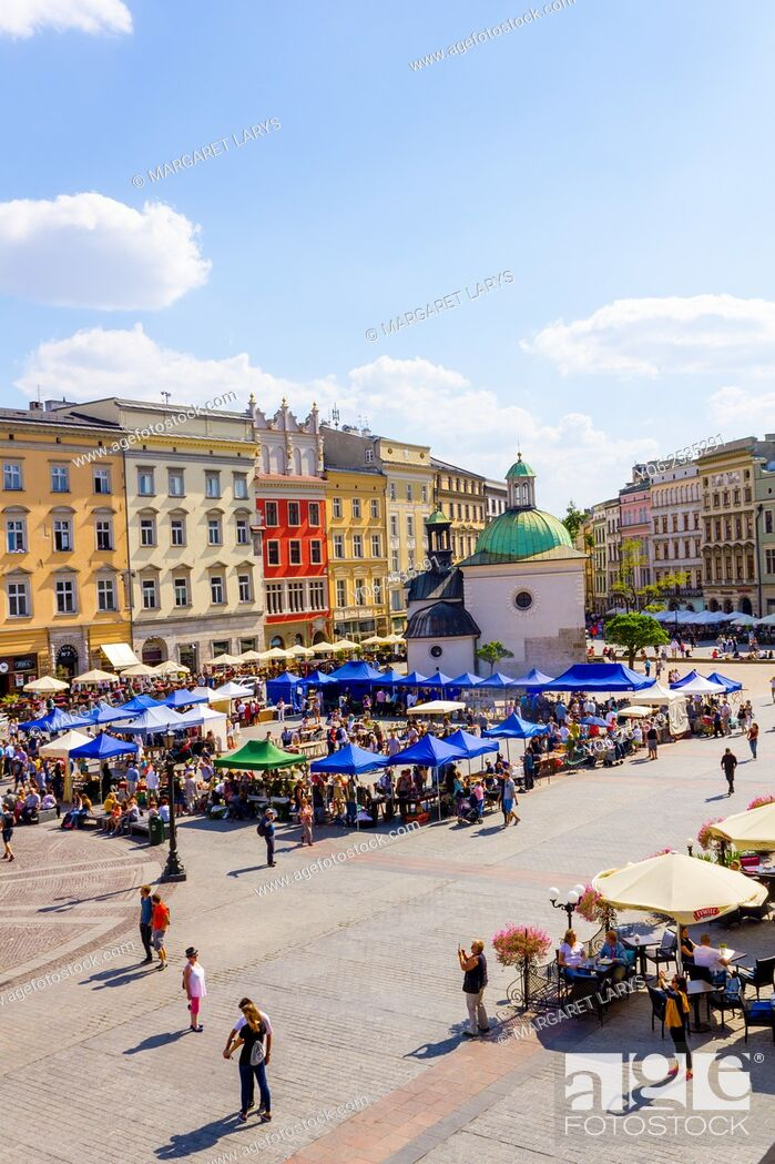 Stock Photo: Tourists in the main square in Krakow, old historical city in Poland, Europe.