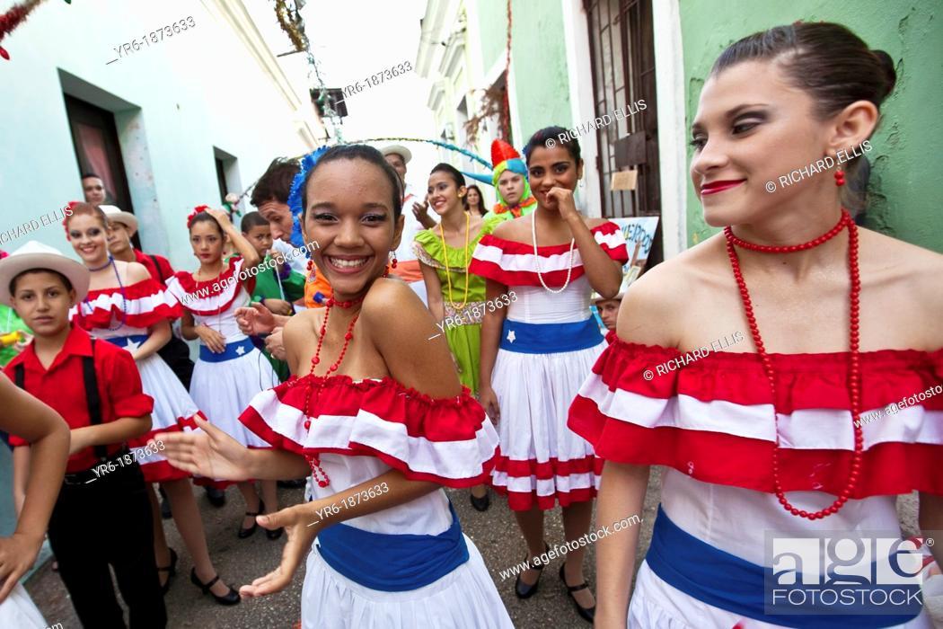 Stock Photo: Dancers parade through the streets of Old San Juan during the Festival of San Sebastian in San Juan, Puerto Rico.