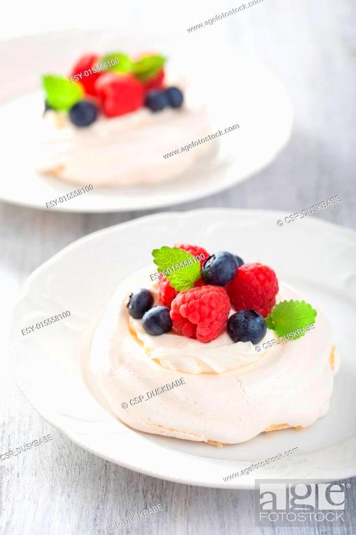 Stock Photo: pavlova meringue cake with cream and berry.