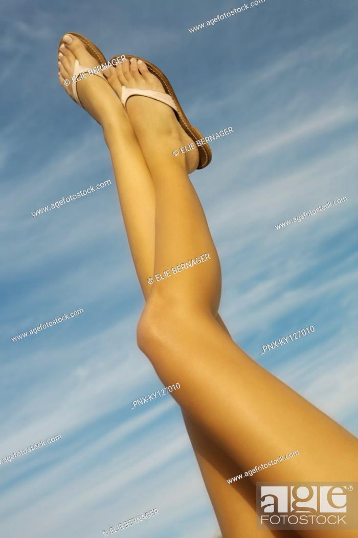 Stock Photo: Woman's legs in the air.