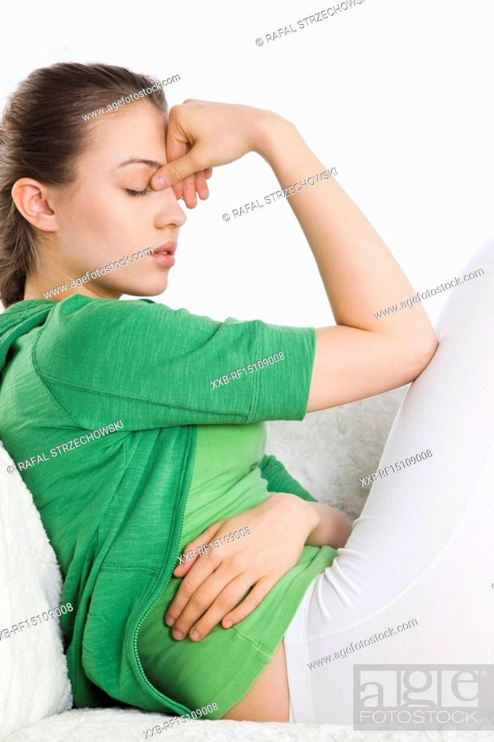 Stock Photo: young woman with stomach ache.
