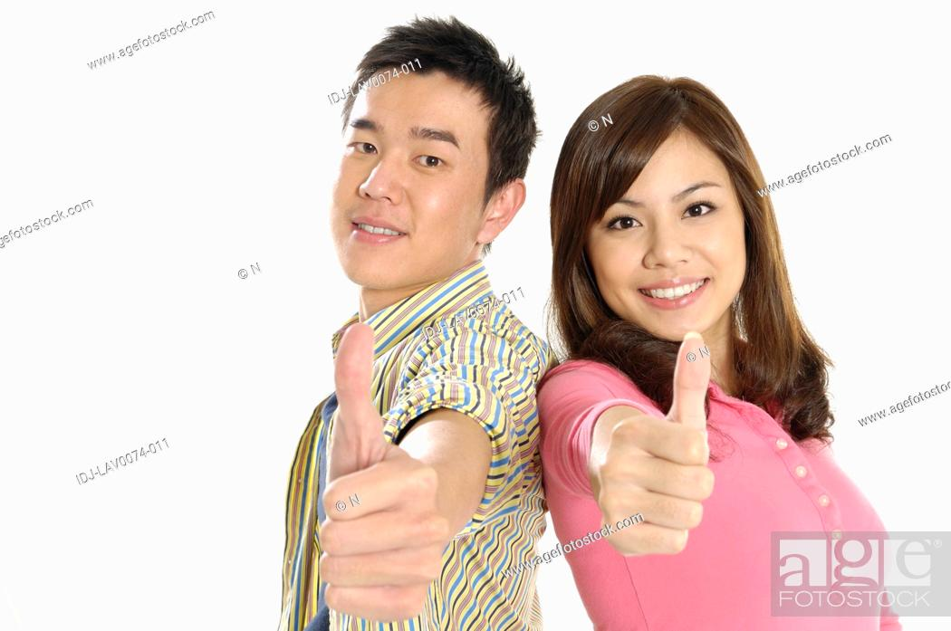Stock Photo: University students showing thumbs up sign.