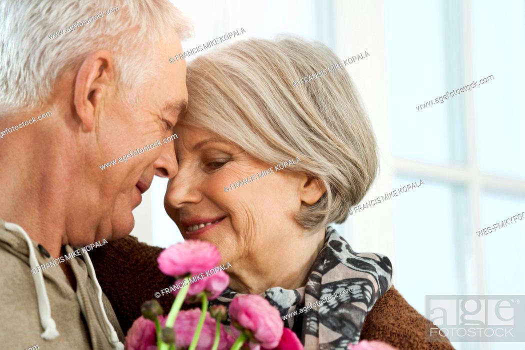 Stock Photo: Germany, Berlin, Senior couple smiling.
