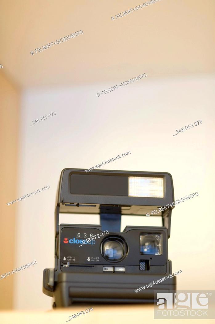 Stock Photo: Black polaroid camera.