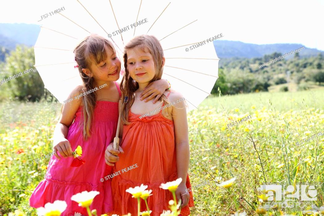 Stock Photo: Two little girls in meadow.