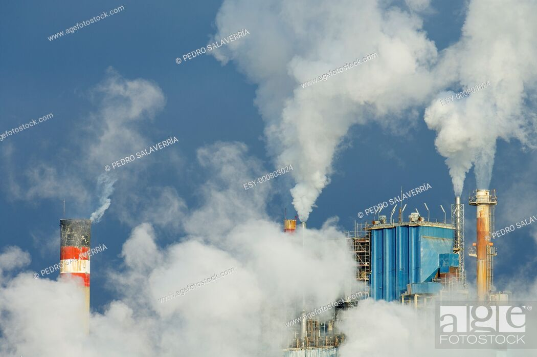 Stock Photo: smoke produced by the smokestacks of a paper mill in Montanana, Saragossa, Aragon, Spain.