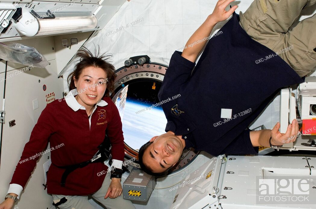 Stock Photo: Japan Aerospace Exploration Agency (JAXA) astronauts Naoko Yamazaki (left), STS-131 mission specialist; and Soichi Noguchi, Expedition 23 flight engineer.