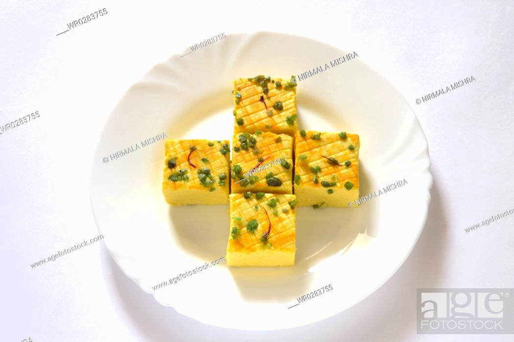 Stock Photo: Indian sweet , sandesh bengali mithai garnish with pistachio and saffron served in plate.