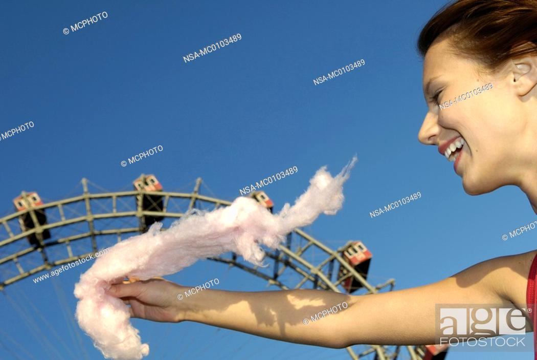 Stock Photo: amusement park Prater Vienna, young woman with candy floss, Giant Ferry Wheel.