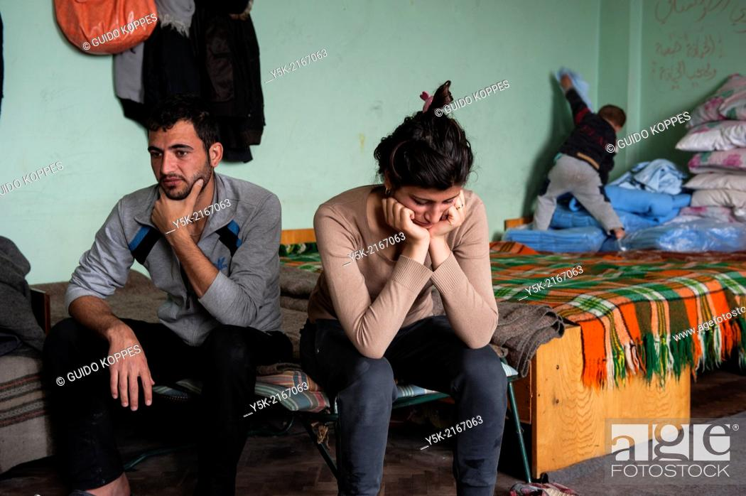 Stock Photo: Sofia, Bulgaria. Married Syrian refugee couple, living in boredom and without privacy in refugee camp Vrajdebna.