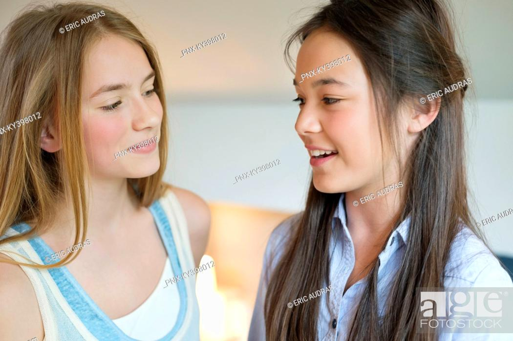 Stock Photo: Close-up of two girls smiling.