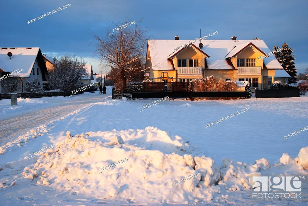 Stock Photo: Piles of snow from shoveling snow in a Bavarian village.