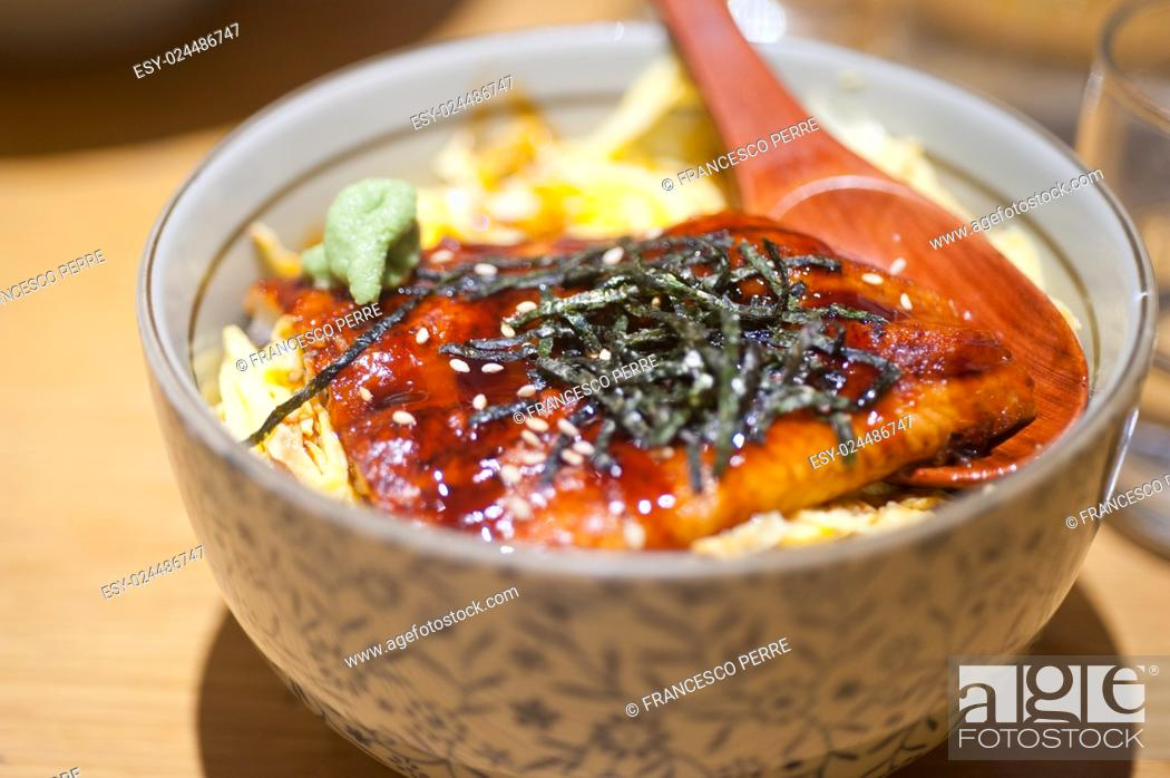 Stock Photo: traditional Japanese ramen noodles with unagi eel on top.