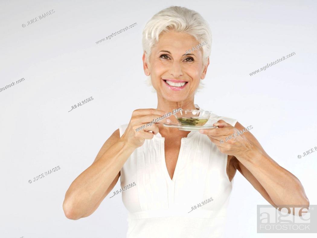 Stock Photo: Happy senior woman with tea, portrait.