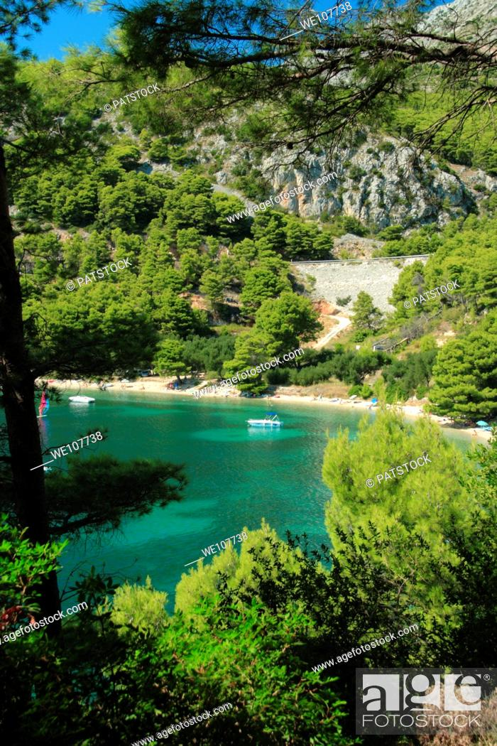 Stock Photo: Tourists resting at a spectacular bay in Zivogosce village, Croatia.