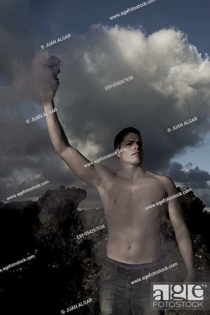 Stock Photo: Shirtless man with smoke pellet.