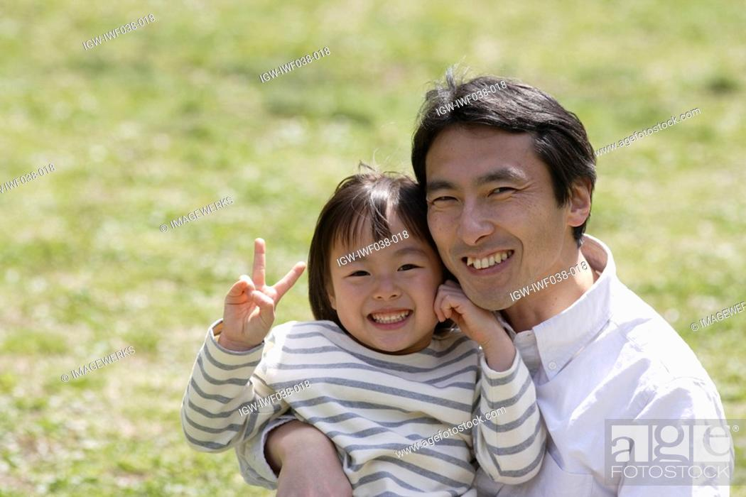 Stock Photo: Portrait of a father smiling with daughter.
