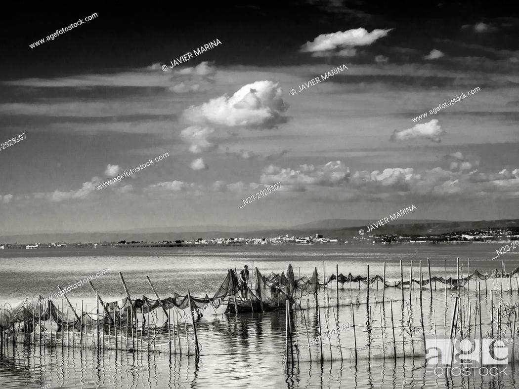 Stock Photo: Fishermen in the Albufera, Valencia, Spain.