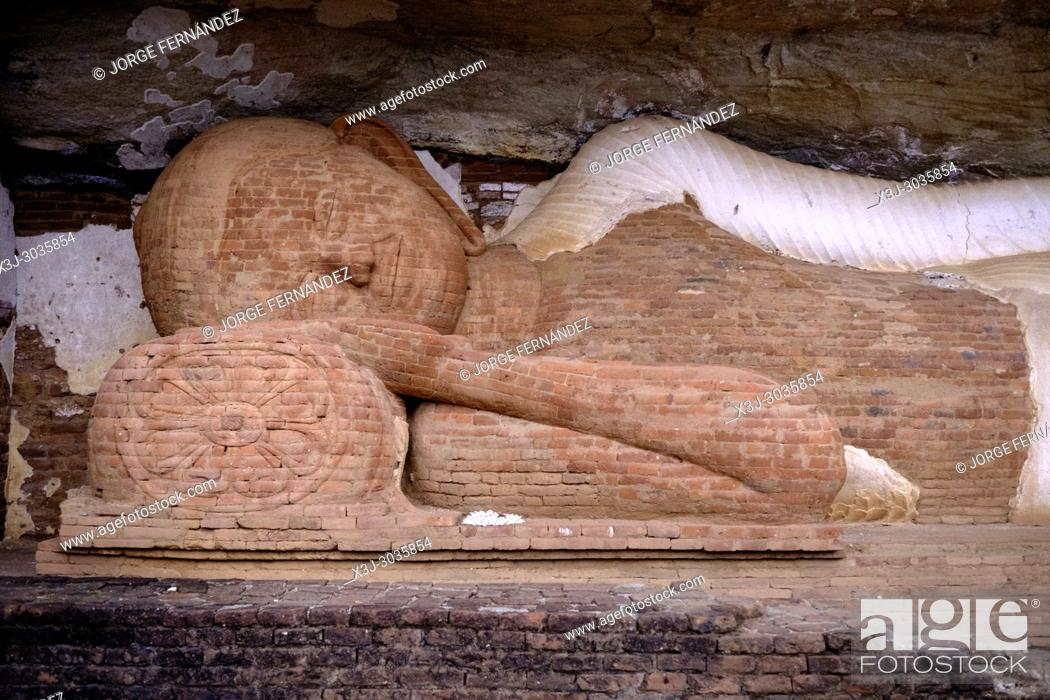 Stock Photo: Statue of sleeping Budha on the way to Pidurangala rock. Sri Lanka.