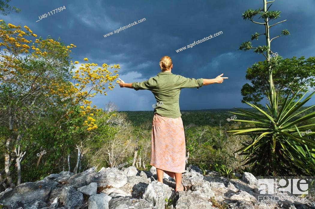 Stock Photo: Guatemala, Peten, El Mirador basin, Woman on top of Temple Los Monos.