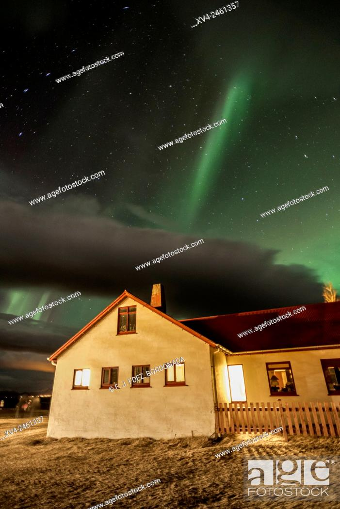 Stock Photo: Northern lights above small village of Iceland southern.