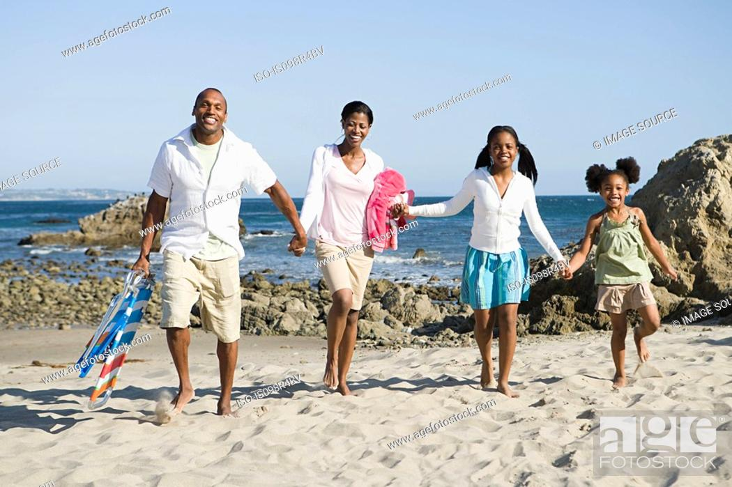 Stock Photo: African american family on a beach.