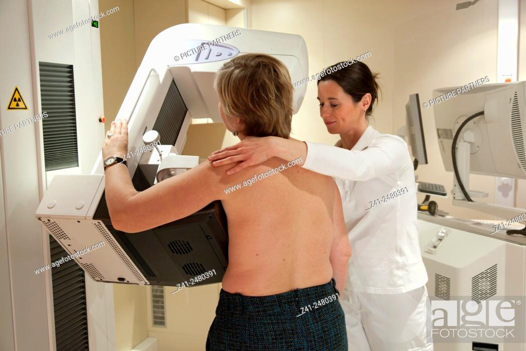 Stock Photo: Radiology technician performs mammography test by xray.