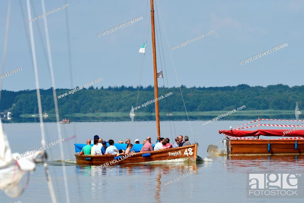 Stock Photo: A boat with excursionists rides in the warm summer weather over Lake Steinhude in the region of Hanover, Germany, 26 July 2016.