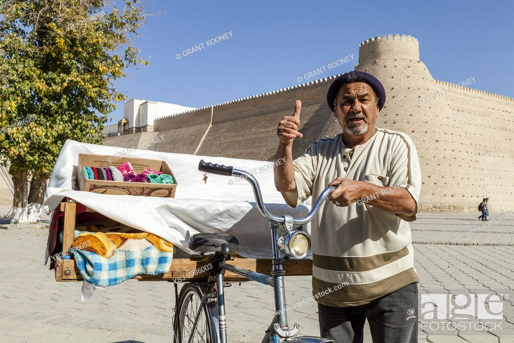 Stock Photo: A Local Man Outside The Ark Fortress Selling Samsa (Meat Pies) From A Bicycle, Bukhara, Uzbekistan.
