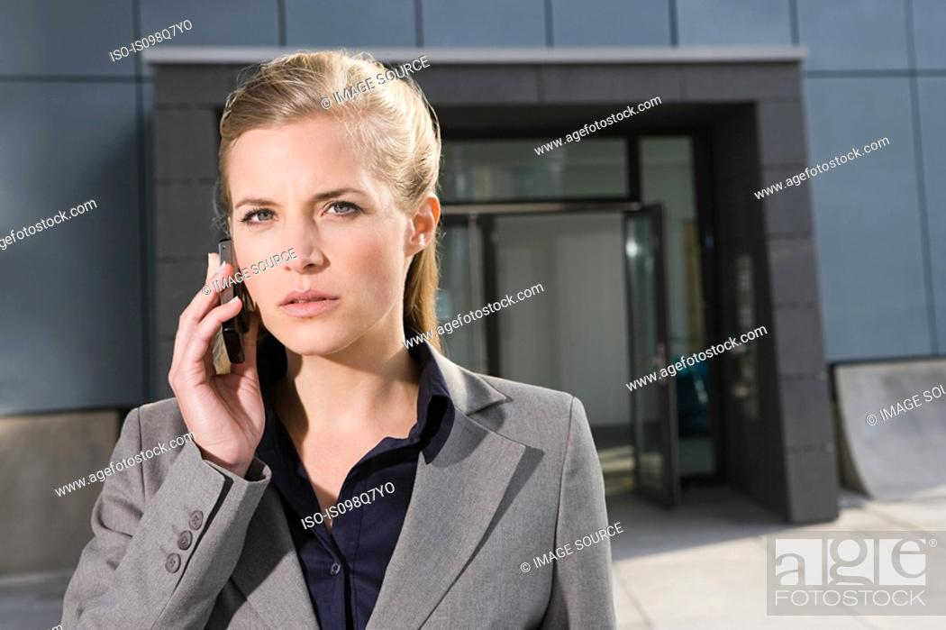 Stock Photo: Businesswoman with cellphone.